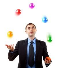 businessman juggling colorful balls