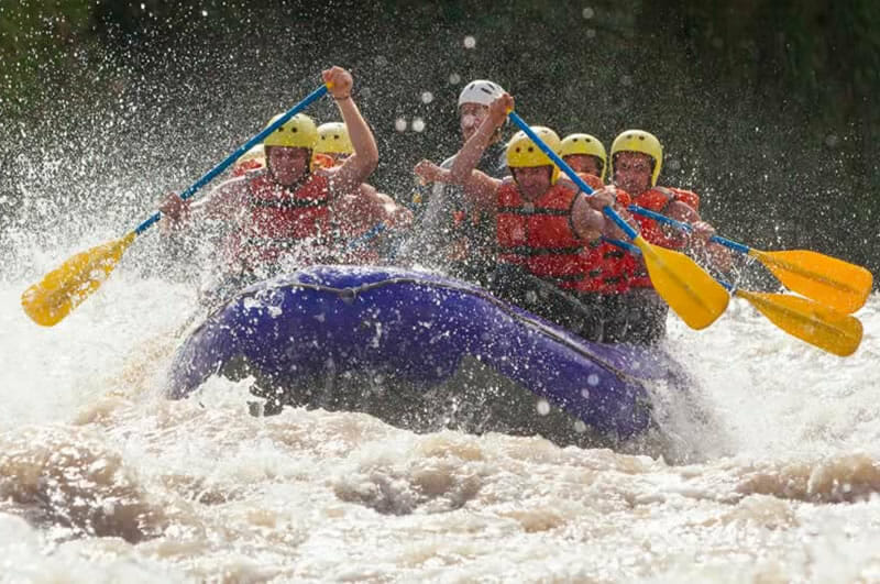 photo of whitewater rafting team in control