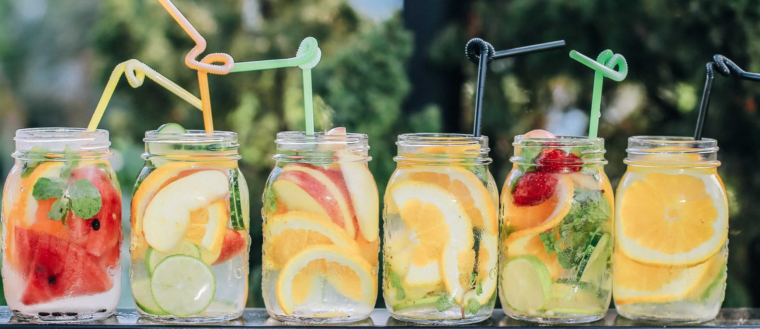 Cultivating trust at the Produce Marketing Association - Unsplash photo of fresh fruit in ice water jars by Kaizen Nguyễn