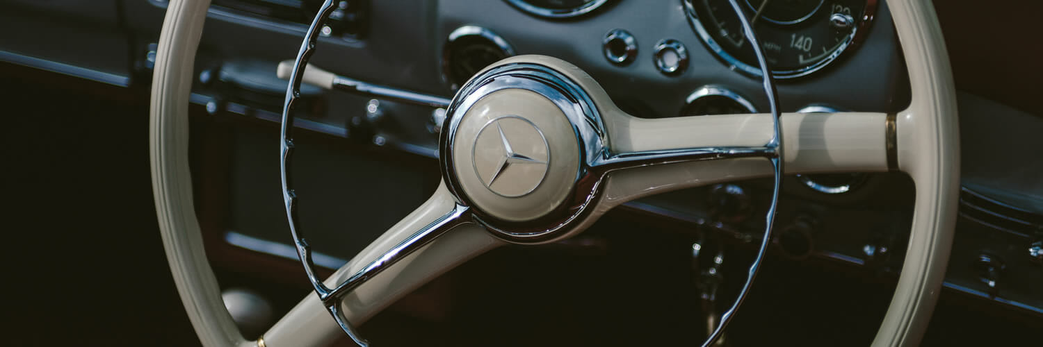 Unsplash.com photo by Clem Onojeghuo - driving your brand with emotional intelligence - steering wheel of a classic Mercedes Benz