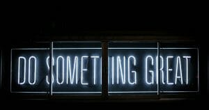 How to have a great sales conference - Do something great neon sign - Photo by Clark Tibbs on Unsplash