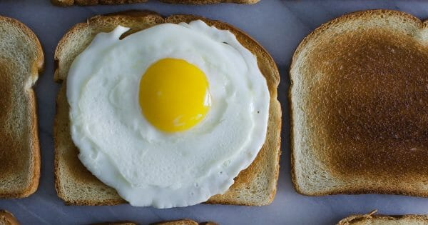 Culture eats strategy for breakfast - how to build a culture of trust. Photo of egg on toast by Leti Kugler on Unsplash