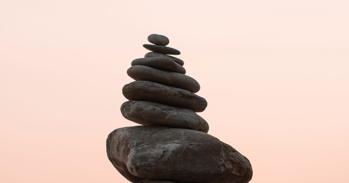 Photo of rocks balanced in a stack by Bekir Dönmez on Unsplash