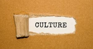 Make culture count - The text Culture appearing behind torn brown paper