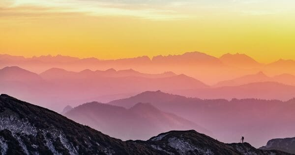 Contributing as a Multiplier - hiker on mountaintop - Photo by Simon Matzinger on Unsplash
