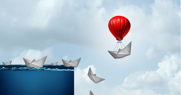 Leading in a Crisis (art of paper ships falling off a cliff except one is saved by a hot air balloon)
