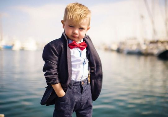 photo of serious young boy dressed for business