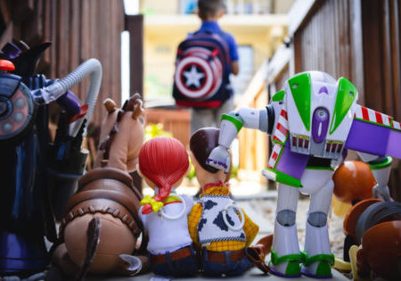 Photo of Toy Story action figures watching a boy go back to school by Chris Hardy on Unsplash